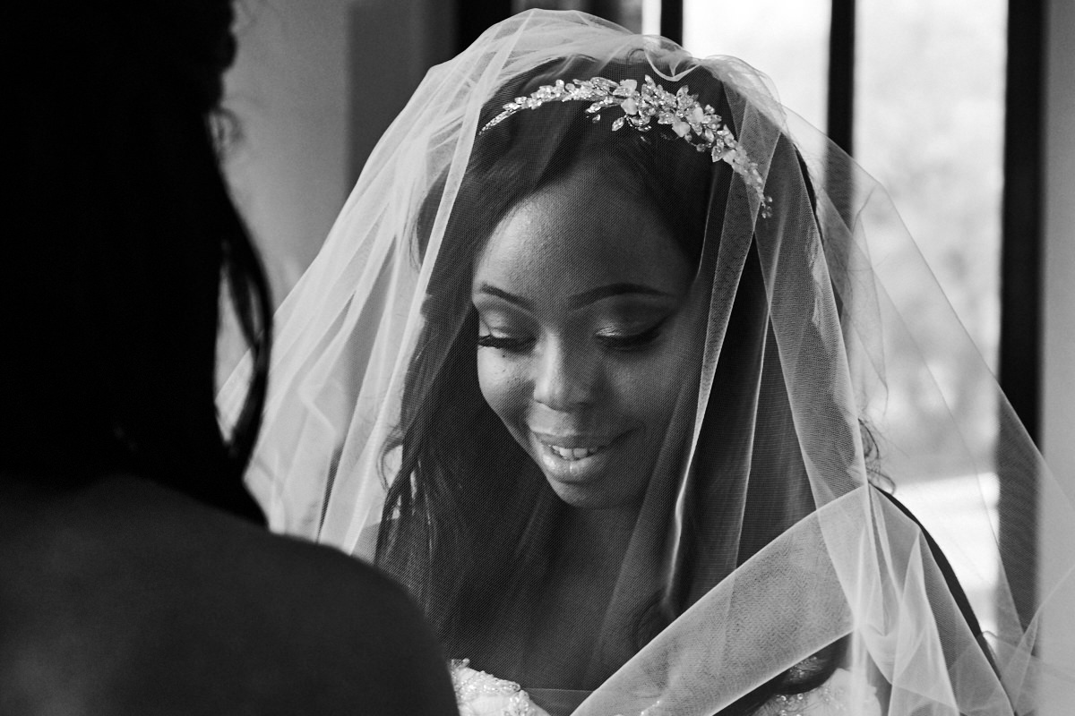 a bride getting ready to go in to the church to get married