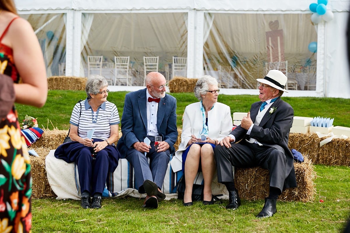 guests talking at a Sussex marquee wedding