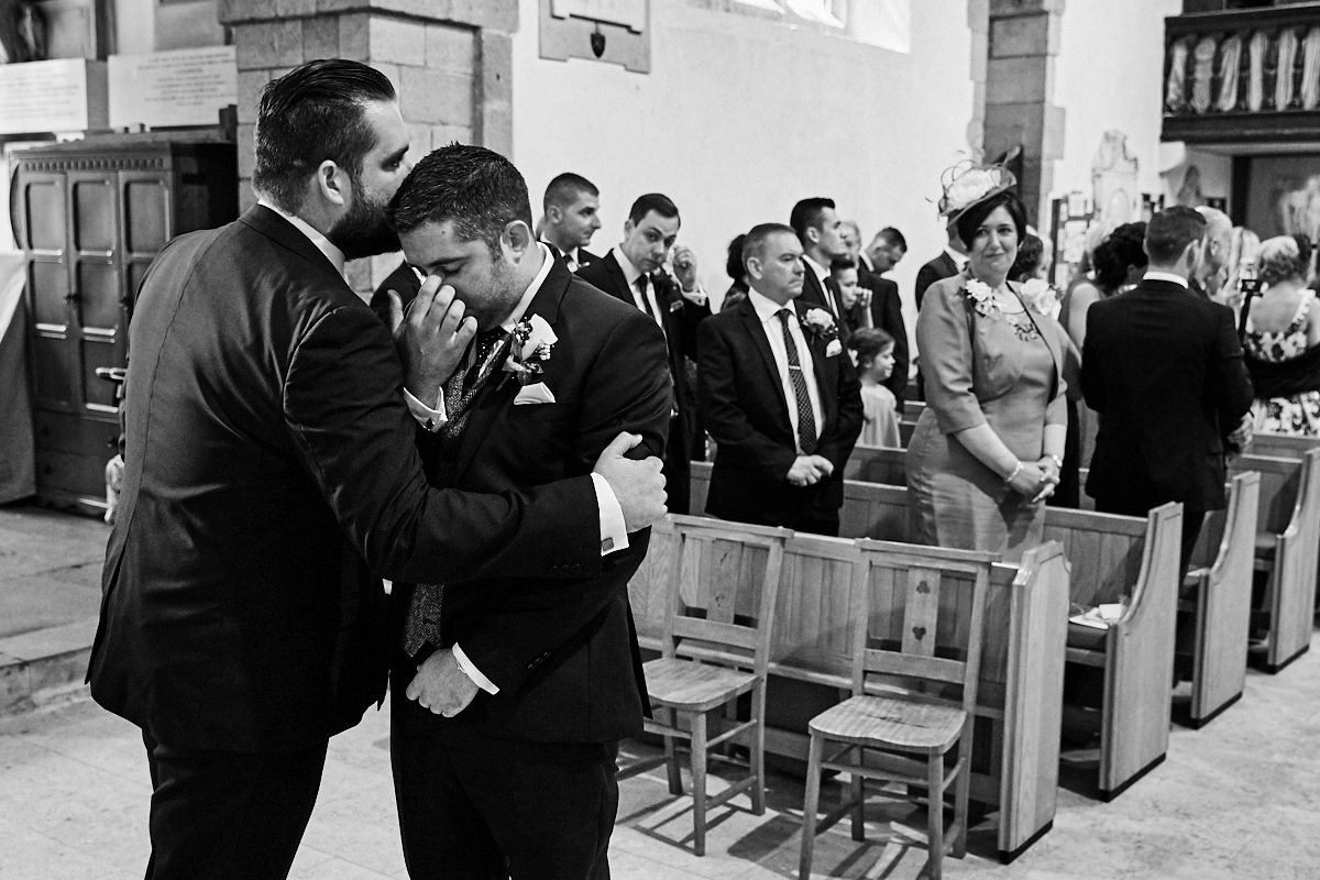 the groom and his brother getting ready for his bride to walk in to the ceremony