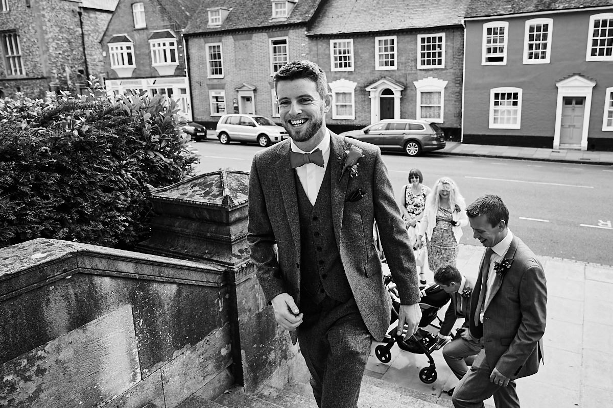 a groom entering Ede's House in Sussex for his wedding ceremony