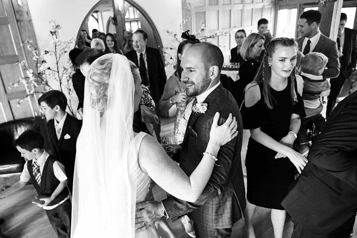 the best man congratulates the bride after the wedding ceremony