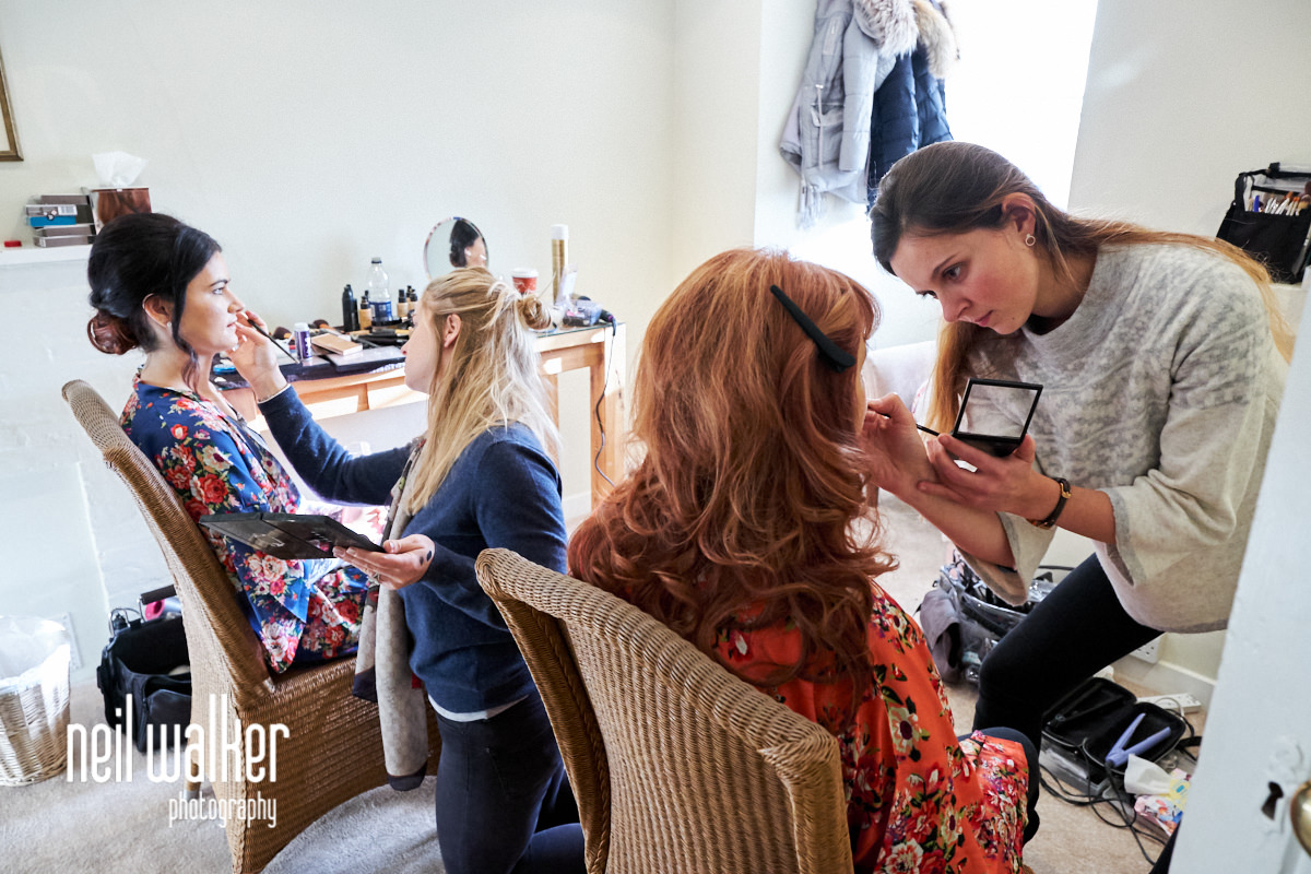 the bride and her aunt having their makeup done
