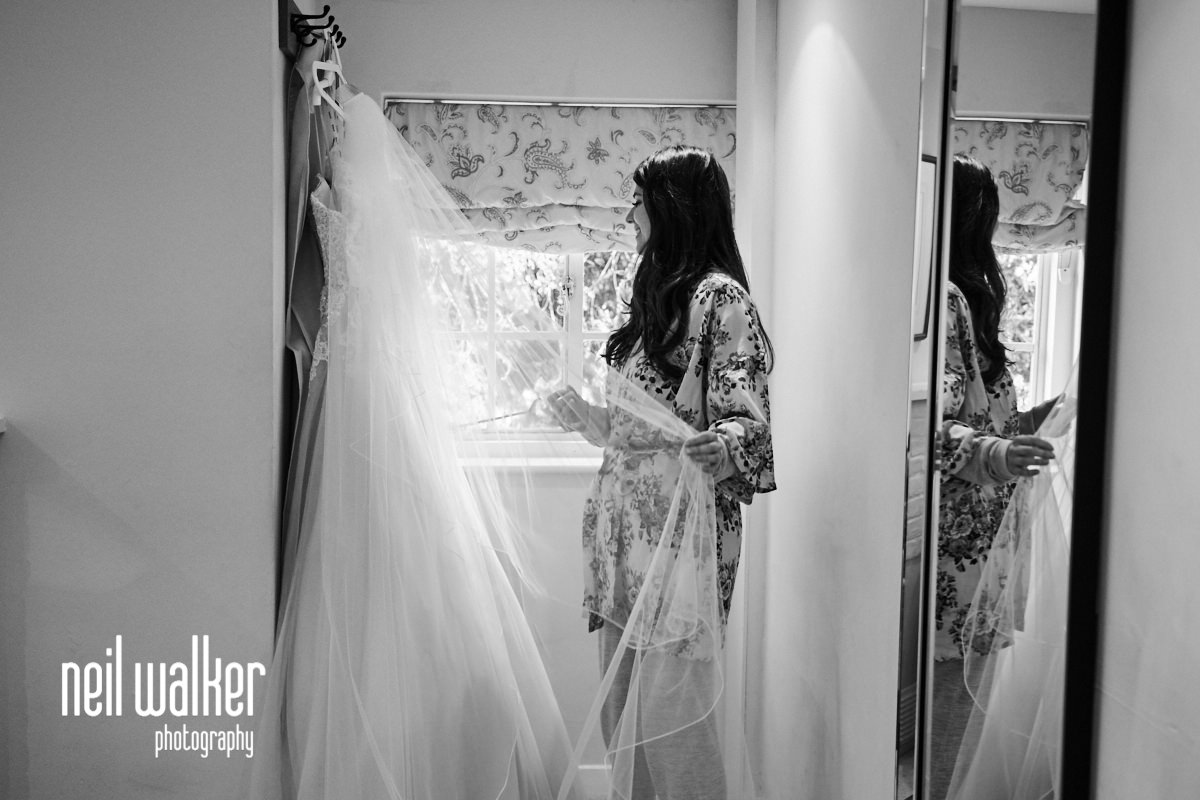 the bride looking at her dress