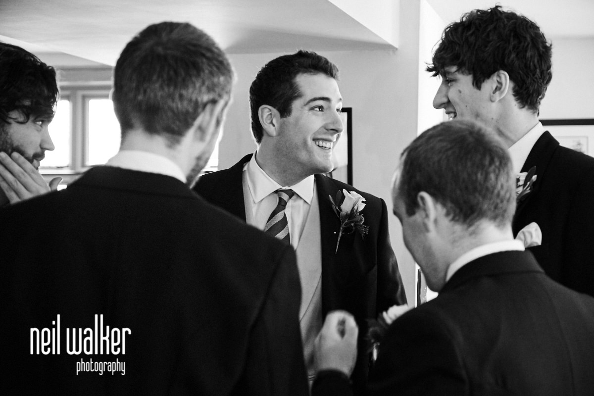 the groom talking to his best man