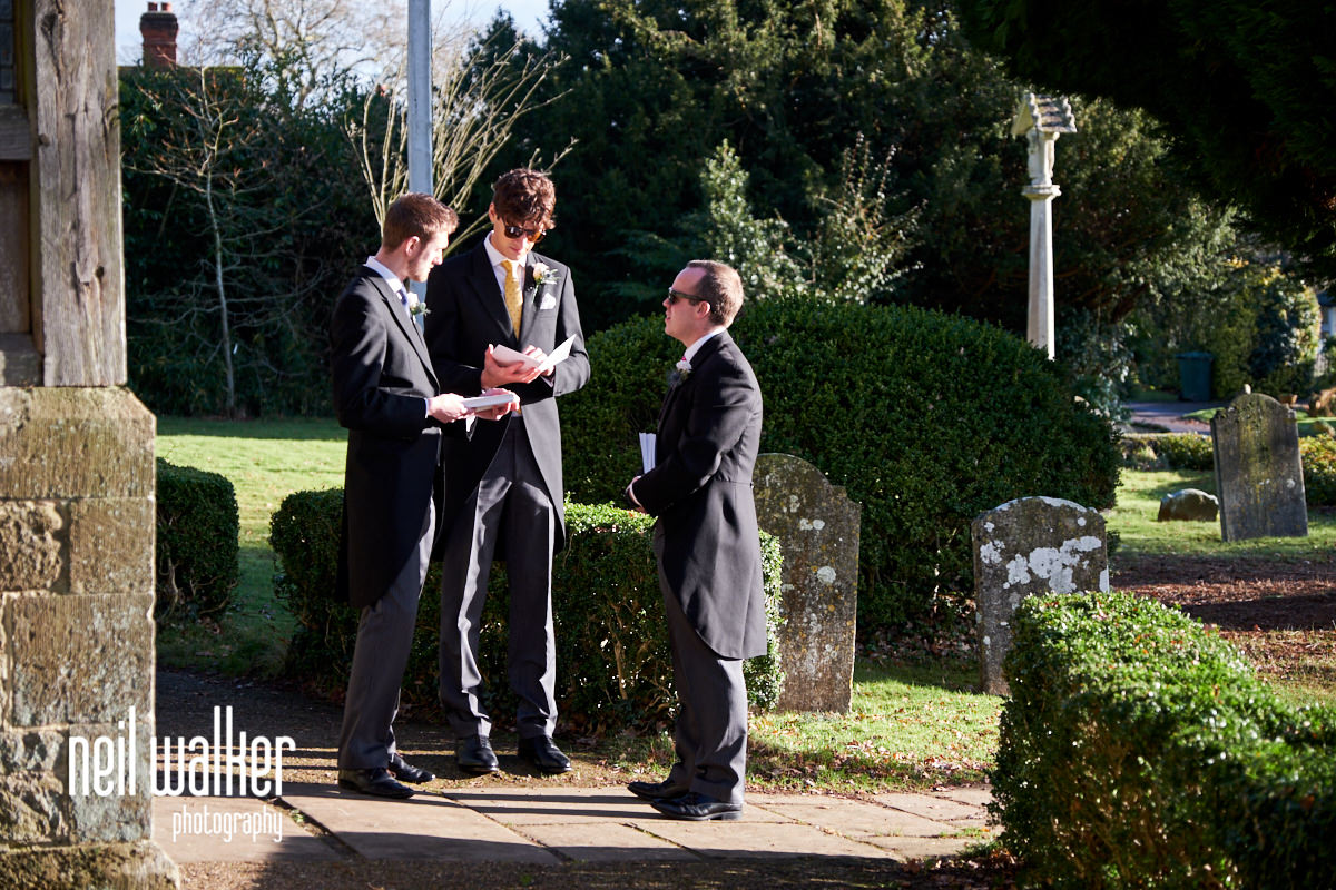 the groomsmen outside the church