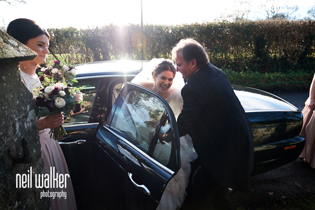 the bride getting out of her wedding car