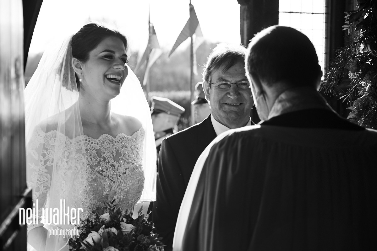 the bride smiling at the vicar
