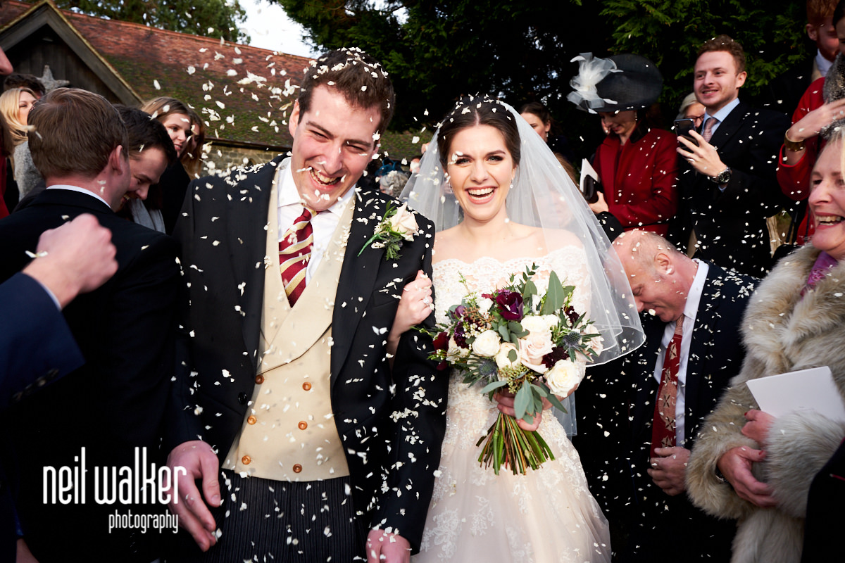 the bride and groom at the end of the confetti throwing