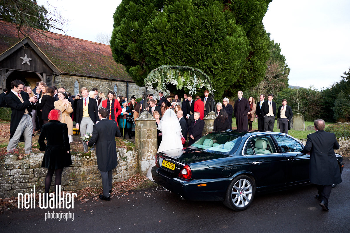 the wedding car waiting for the bride and groom