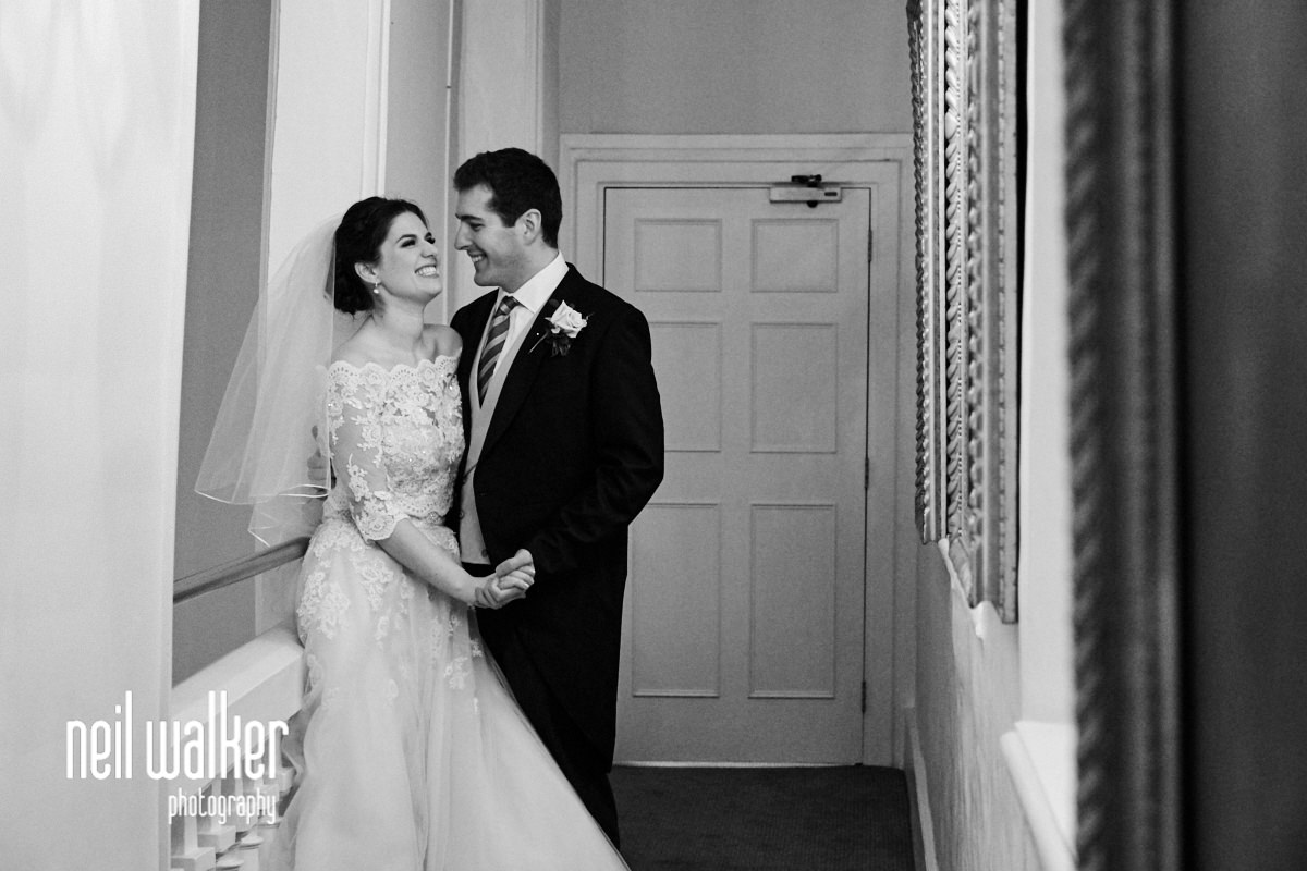 the bride and groom on the balcony above the main room at Farnham Castle