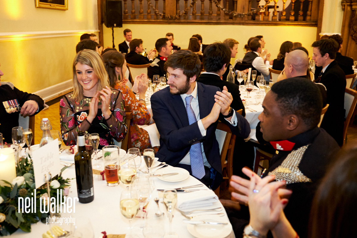 guests laughing at the father of the bride's speech