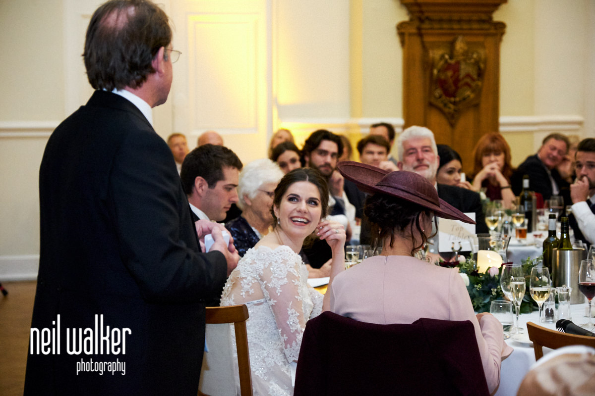 the bride looking round at her father as he makes a speech