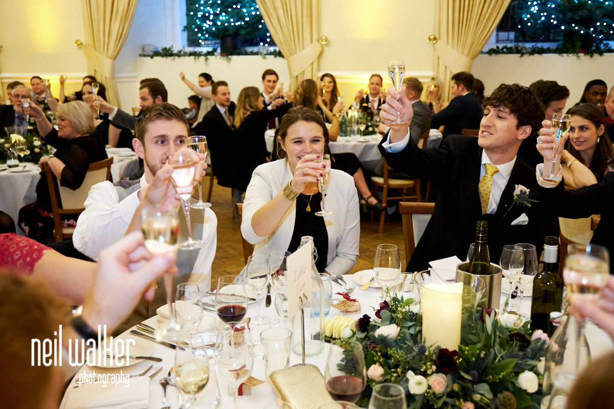 guests laughing as the father of the bride makes a speech