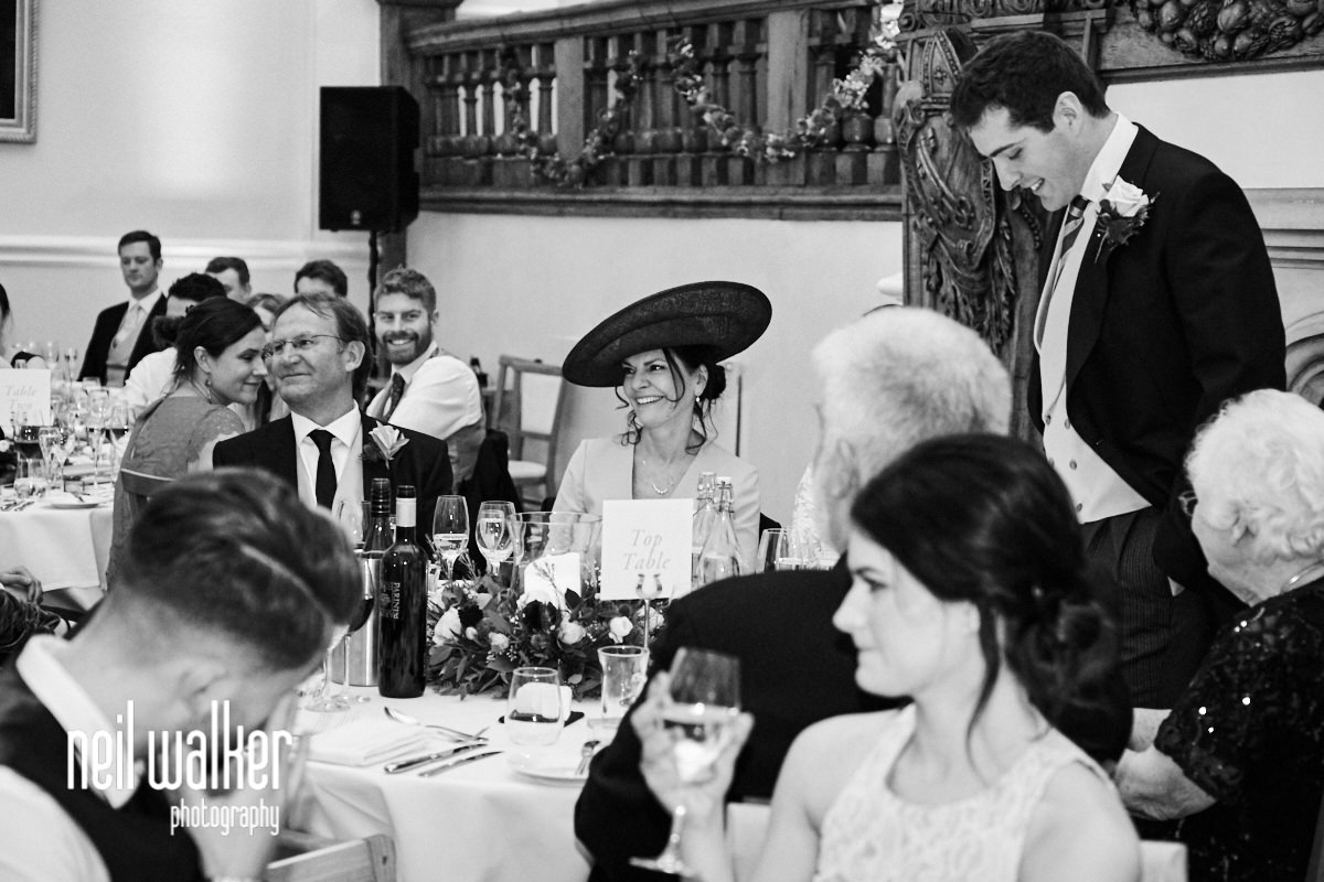 the mother of the bride laughing at he groom's speech