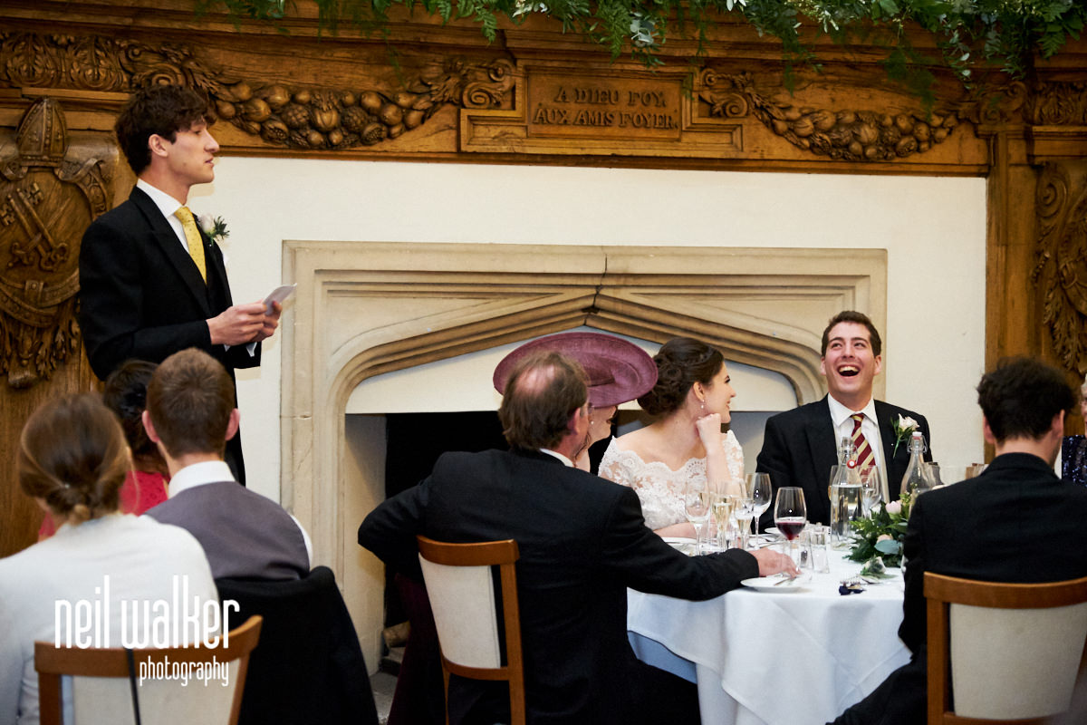 the groom laughing at the best man's speech