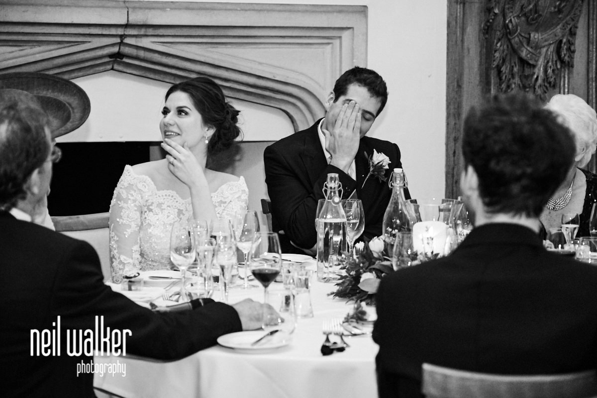 the groom rubbing his face during the best man's speech