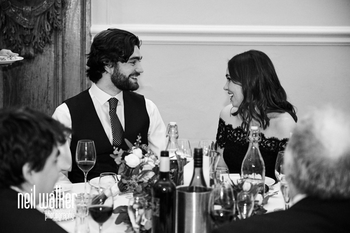 the bride's brother and his wife talking