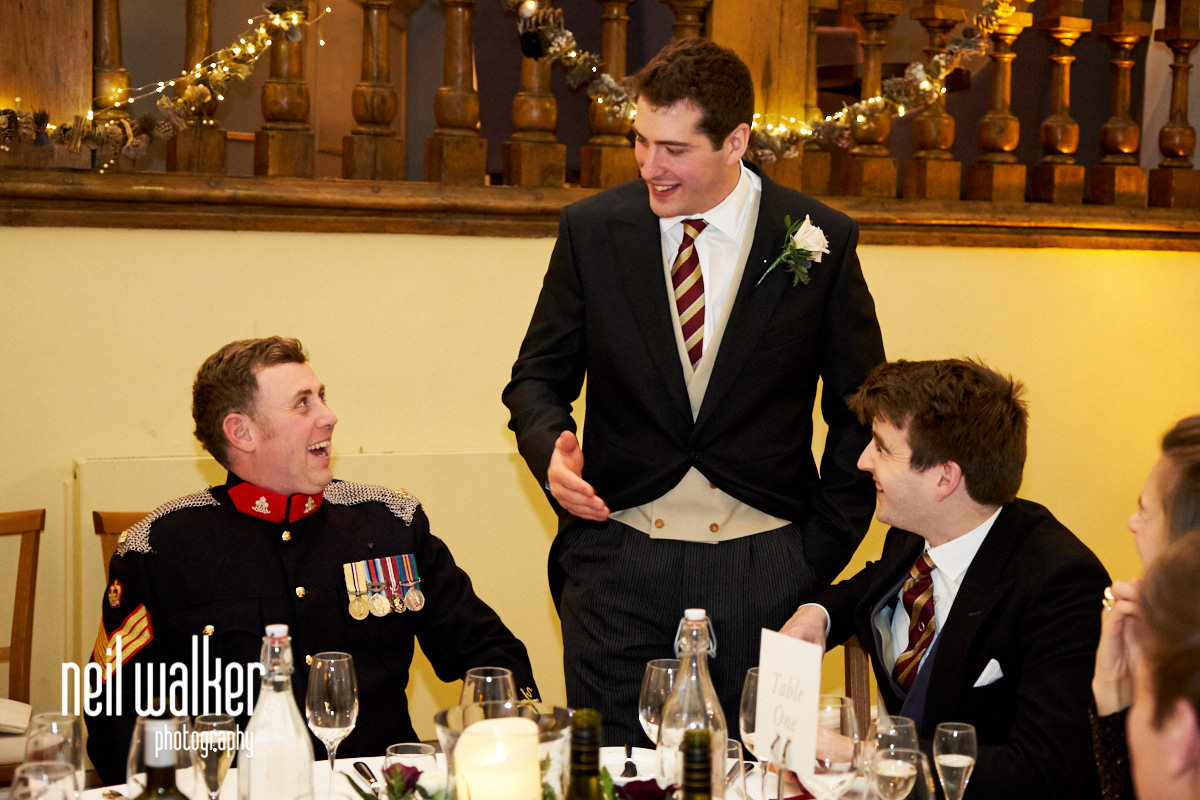 the groom talking to guests