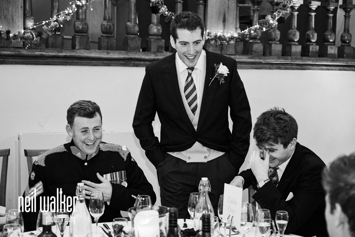 the groom making guests laugh