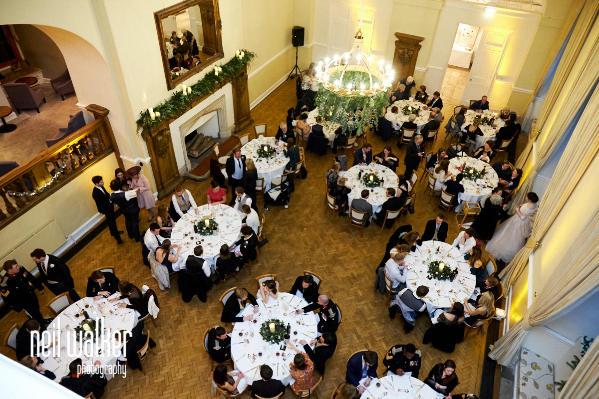 a view of the main hall at Farnham Castle with guests seated at tables