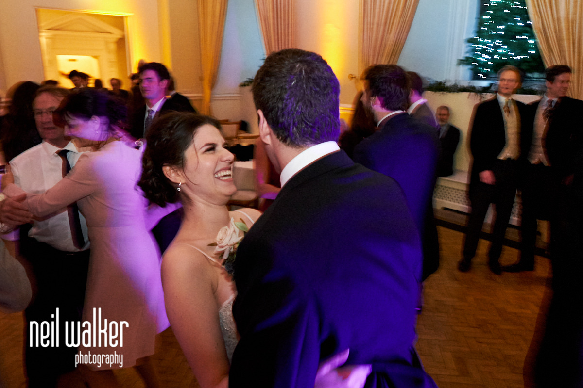 the bride looking at the groom while they dance