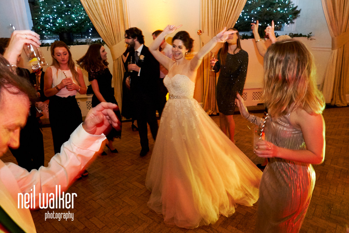 guests dancing and waving their arms