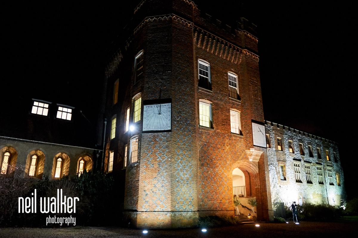 the exterior of Farnham Castle at night