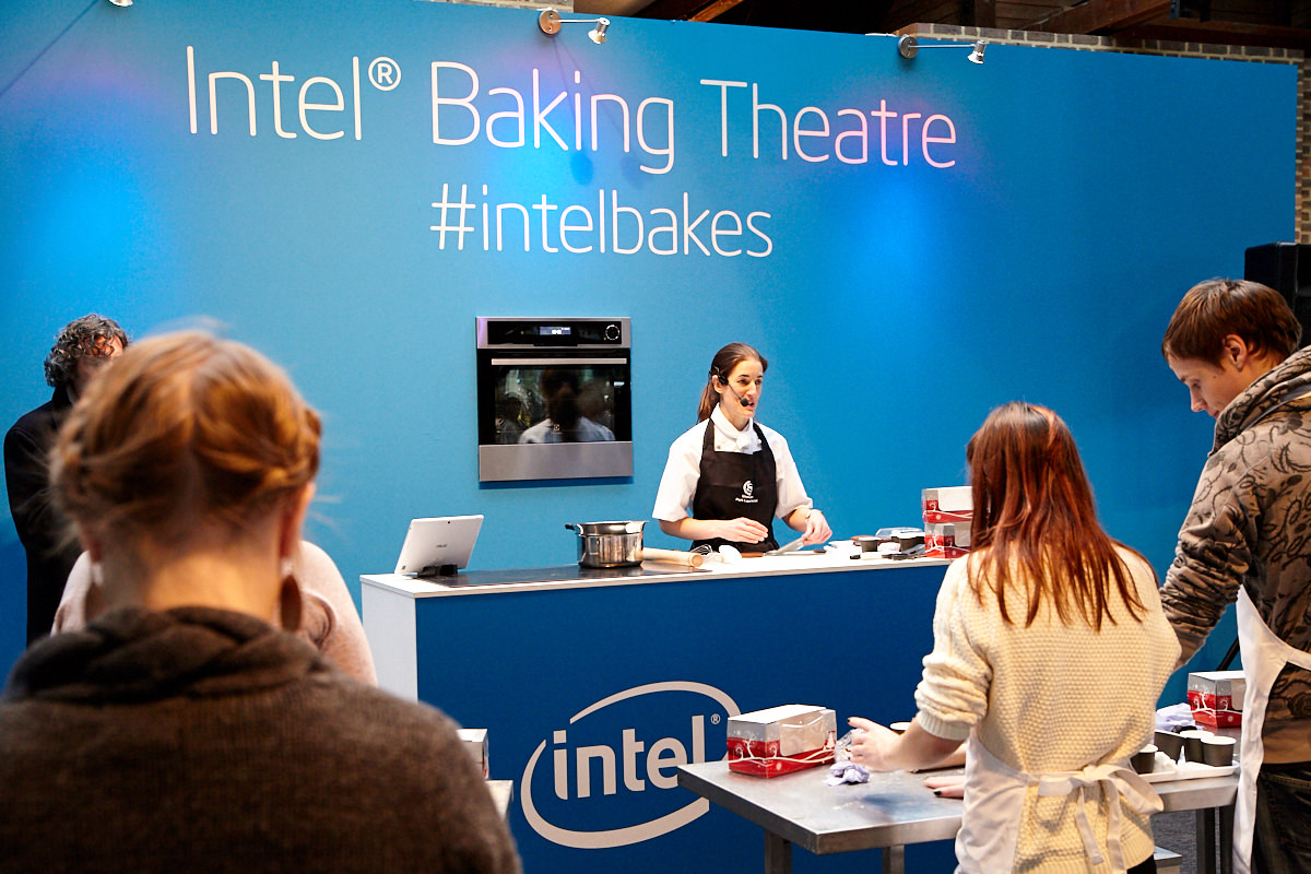 a chef demonstrating how to make a cake at an event in London
