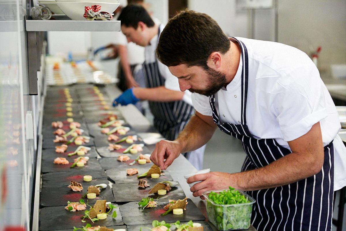 a chef dressing a dessert
