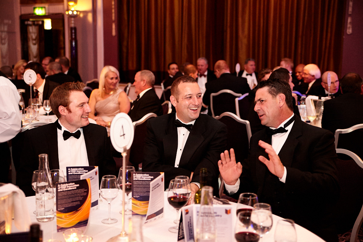 guests laughing at an evening event
