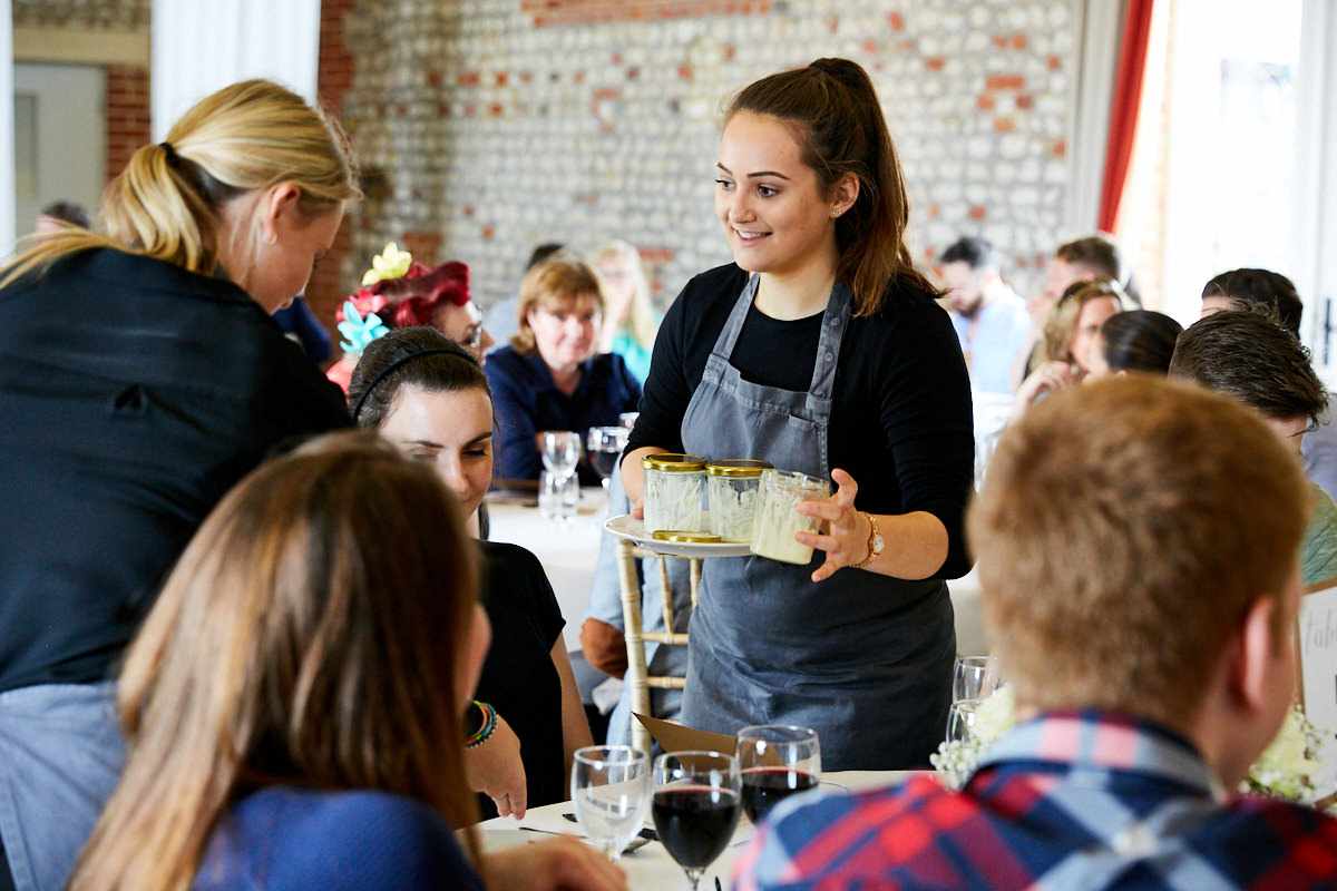 a waitress collecting plates at an event at Farbridge in West Sussex