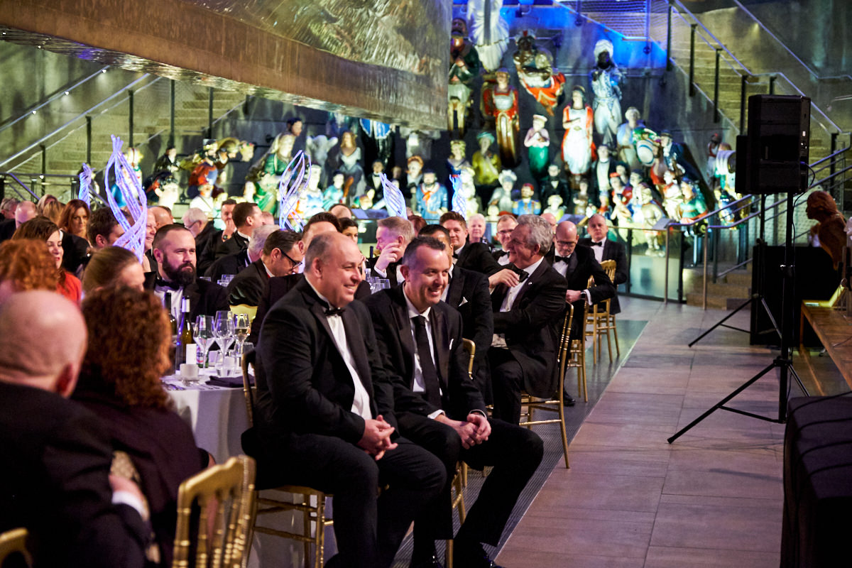 guests listening to speakers at an event at The Cutty Sark