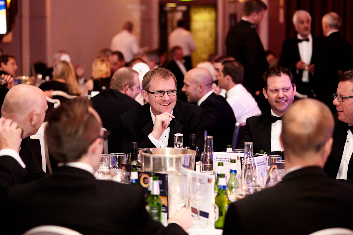 a guest sitting at a table at an event at The Sheraton Grand London Park Lane