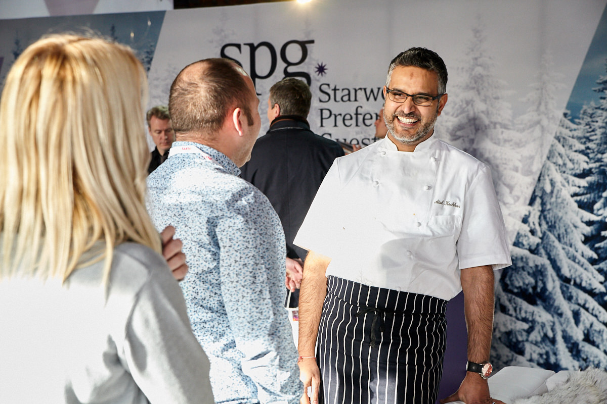 a chef talking to guests at a Starwood event at Tobacco Dock in London