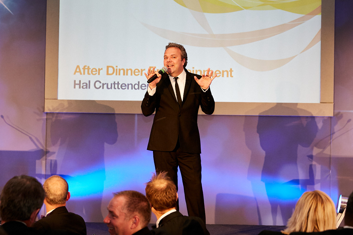 Hal Cruttenden performing at an event at 8 Northumberland Avenue in London