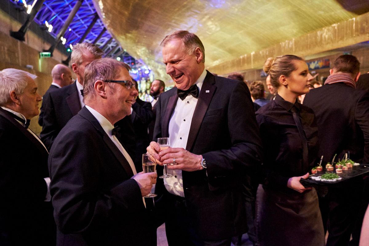 guests talk at an event at The Cutty Sark
