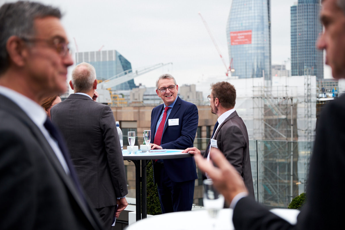 guests talking at an event in London
