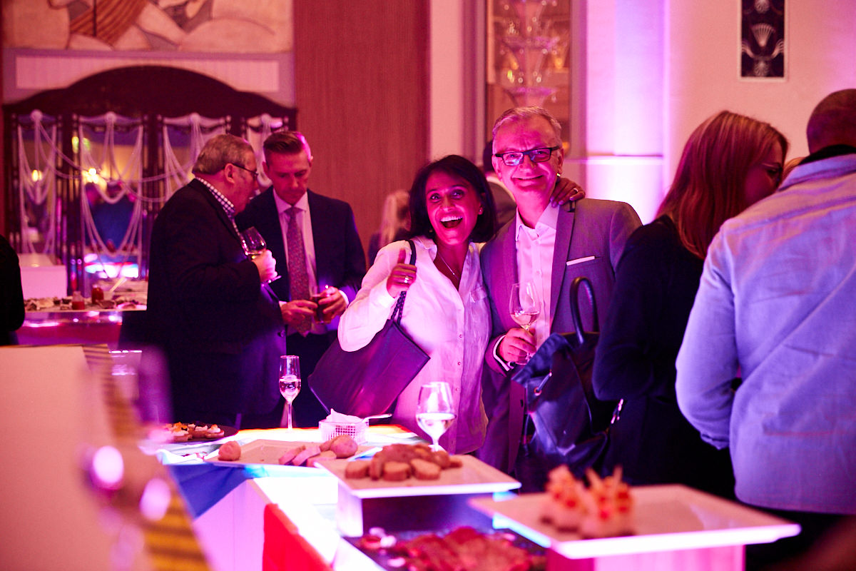 guests laughing at an event at a Starwood event at The Sheraton Grand London Park Lane