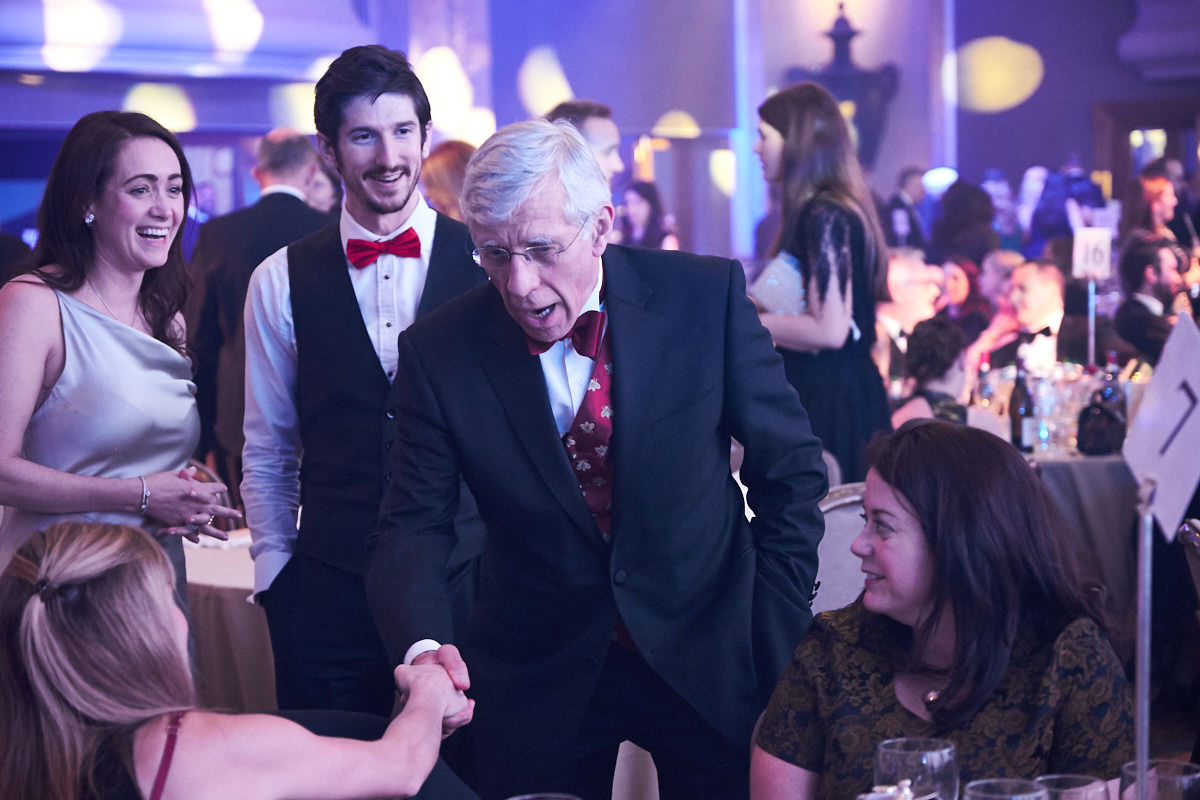 Jack Straw shaking a guest's hand during a Law Society event at The Hilton Park Lane in London