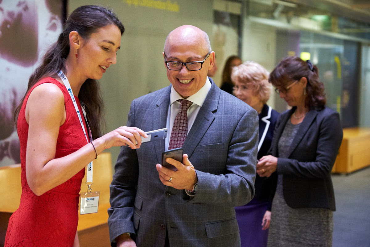 a guest at an event at The Natural History Museum in London learning to use a ticket on his phone