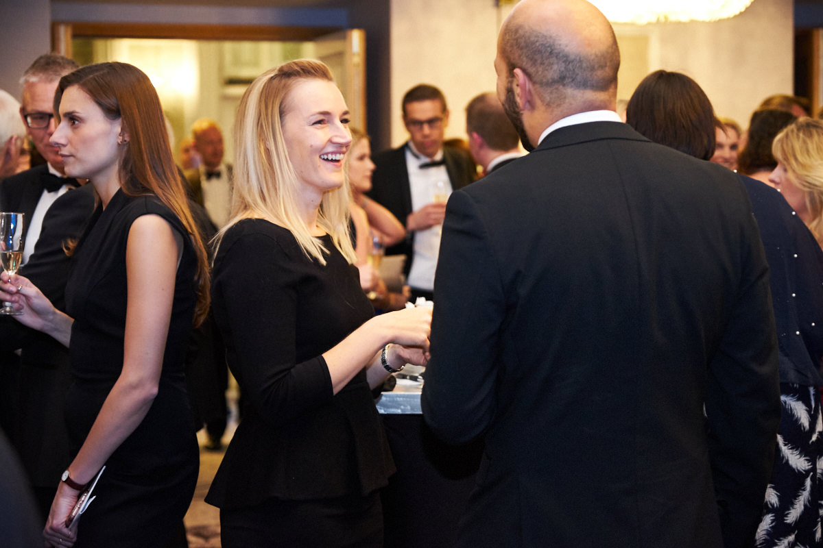 a guest laughing at an event in London