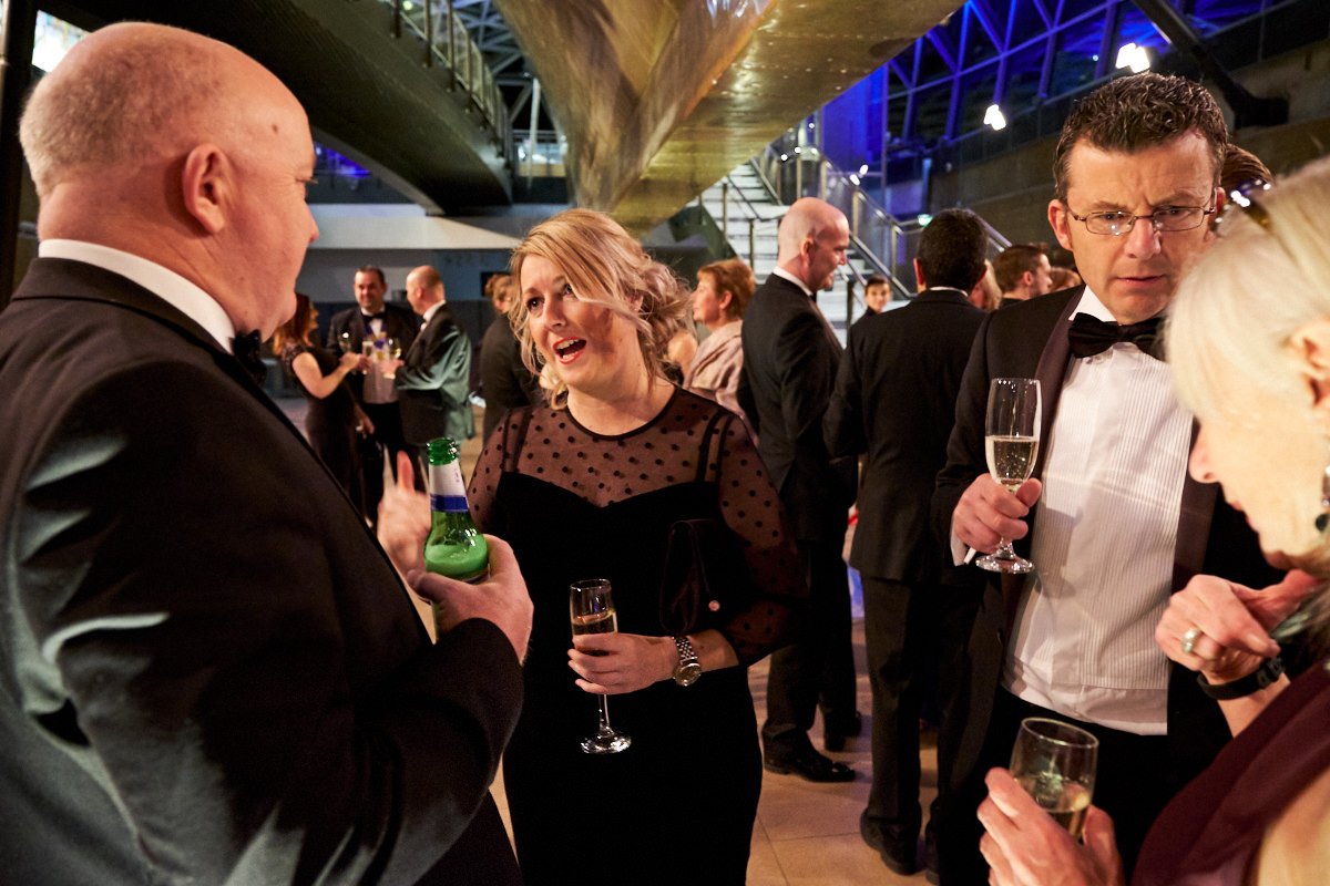 guests at an event at The Cutty Sark talking before dinner is served