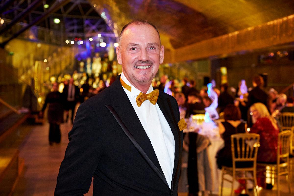 a portrait of a man at an event