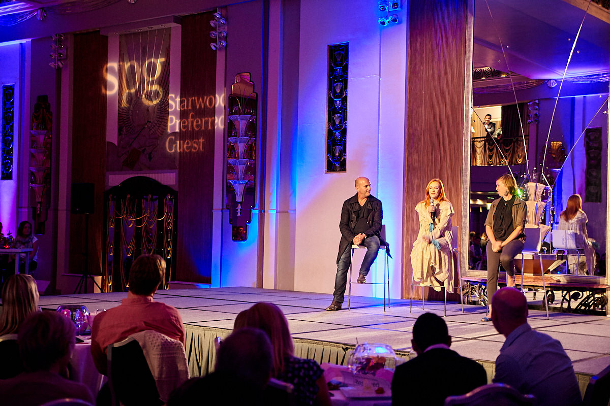 performers talk onstage at a SPG event at The Sheraton Grand London Park Lane