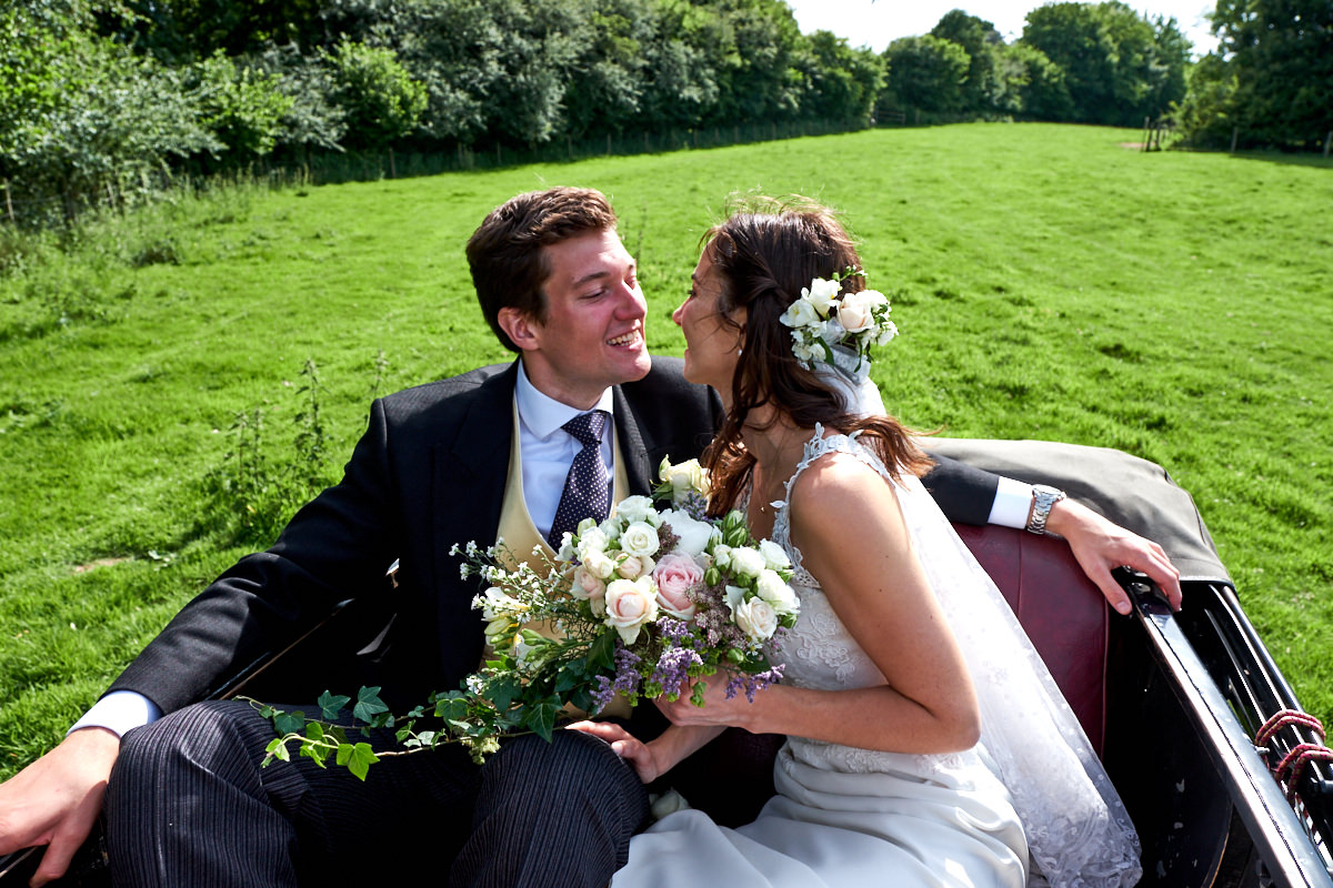 a bride and groom at their Sussex marquee wedding
