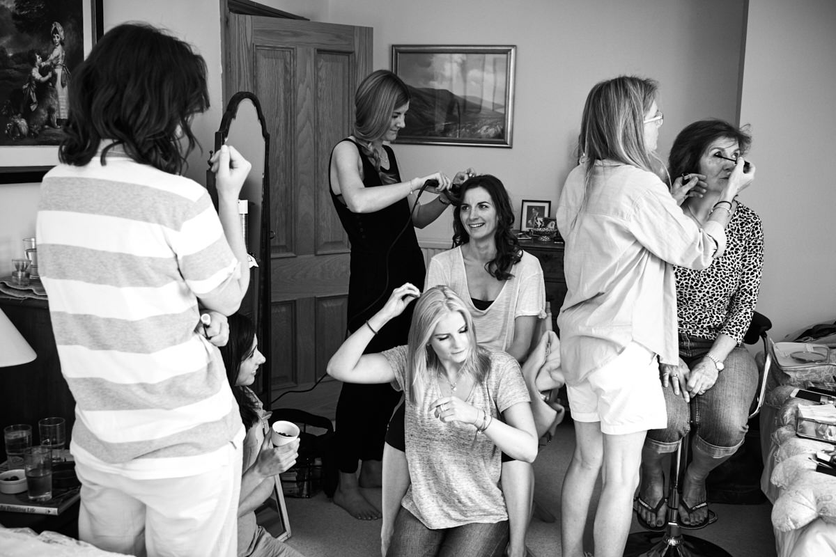 the bride and her bridesmaids getting ready for her marquee wedding in Sussex