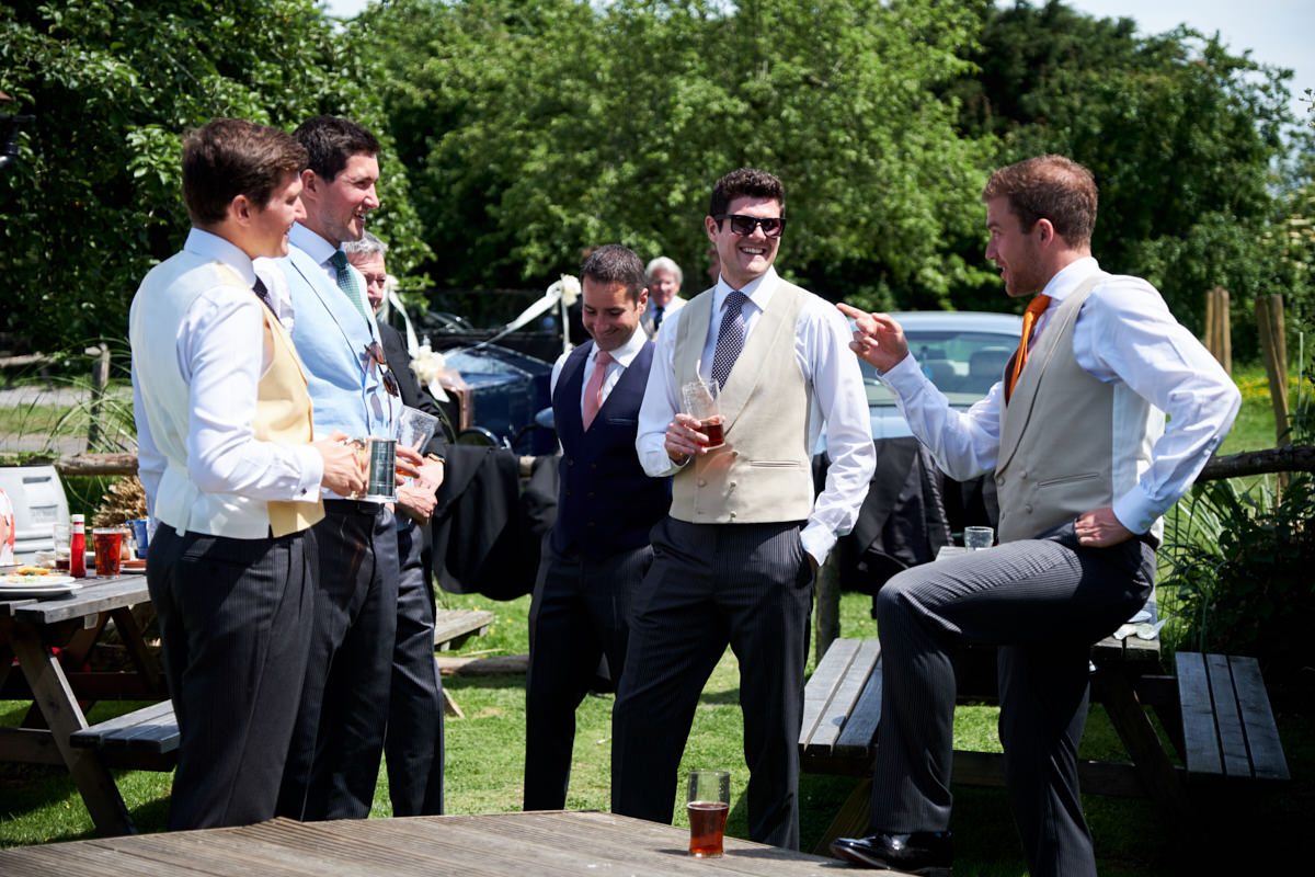the groomsmen relaxing at a pub before the Sussex marquee wedding