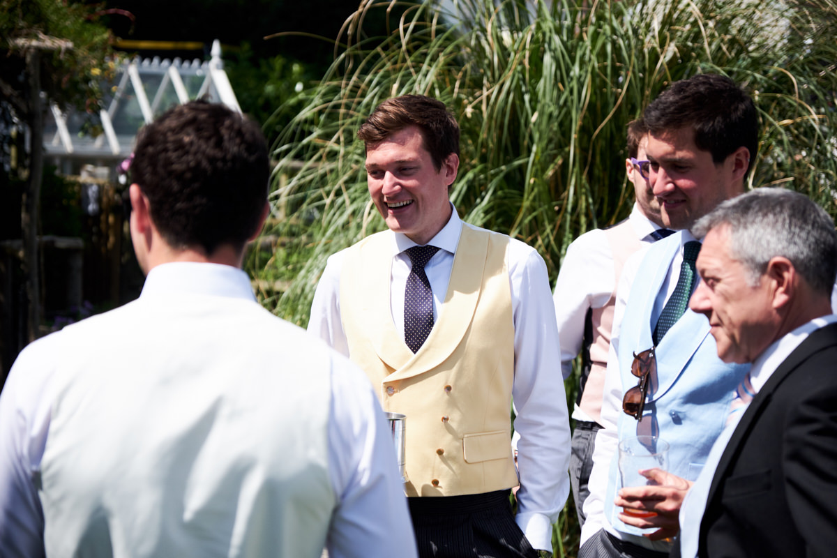 the groom laughing at a joke