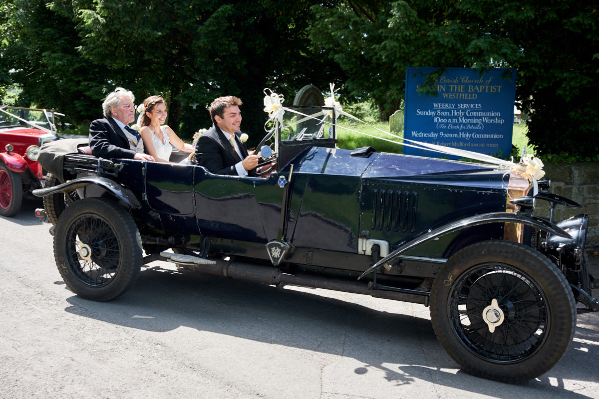 the bride arriving in a vintage wedding car
