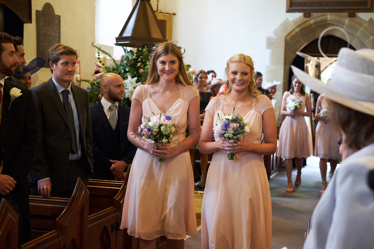 the bridesmaids walk down the aisle